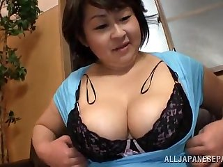 Fat Japanese woman gives a titjob and sucks a dick