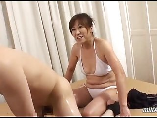 Mature Woman In Bikini Massaging Guy With Lotion Jerking Off His Cock On The Bed