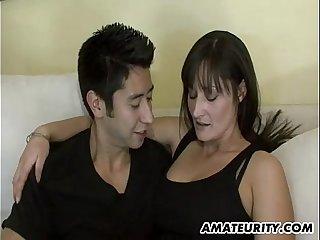 Hot amateur Milf sucks and fucks a young cock