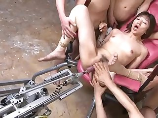 Petite Japanese brunette gets pounded by a fuck machine