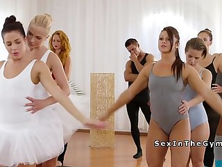 Ballerinas in dresses sharing cock at gym