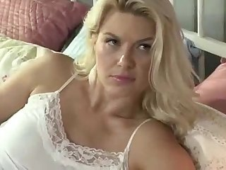 Mature bitch fucks her stepdaughter with strapon